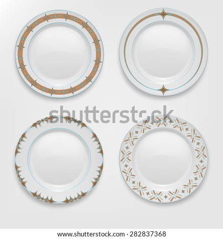 set with patterns on plates. - stock photo