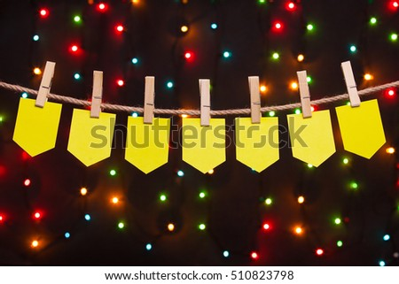seven festive flags on the background of colored lights