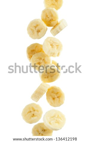 Several banana slices, on white background - stock photo