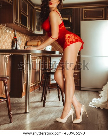 Sexy beautiful brunette girl in red underclothes - stock photo