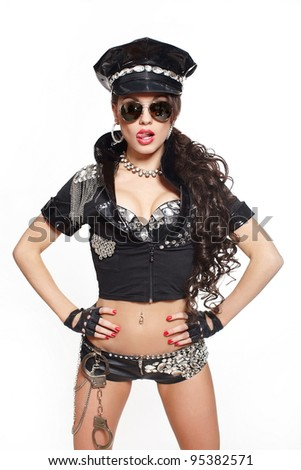 sexy beautiful  brunette semi nude police woman with long curly hair with handcuffs with glasses with bright makeup and red lips isolated on white
