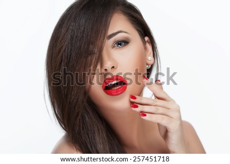 Sexy Beauty Girl with Red Lips and Nails. Provocative Make up. Luxury Woman with Blue Eyes. Fashion Brunette Portrait isolated on a white background. Gorgeous. Woman Face. Long Hair - stock photo