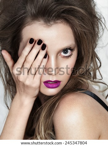 sexy girl covered her face half hand isolated with beauty pink lipstick. high fashion portrait - stock photo