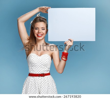 Sexy girl holding a billboard add  - stock photo