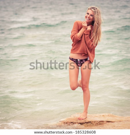 sexy girl poses on a beach. Photo in color style instagram filters - stock photo