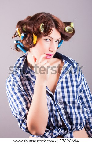sexy housewife with curlers - stock photo
