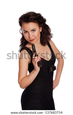 Sexy woman in black dress with a gun on a white background