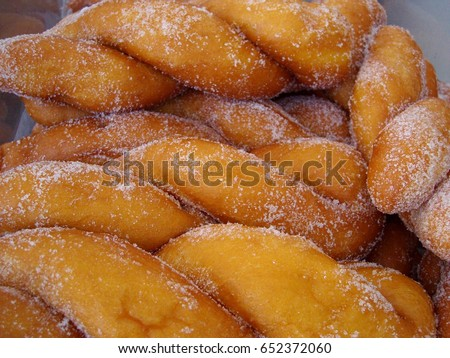 """Shakoy"" or twisted donuts, Philippine favorite dessert Shakoy or ""pilipit"" is a twisted fried donut coated with sugar and is a popular street food in the Philippines."