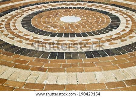 shaped brick paving with circular pattern - stock photo