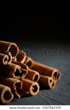 shelves of cinnamon in dark colors on a dark concrete stone background