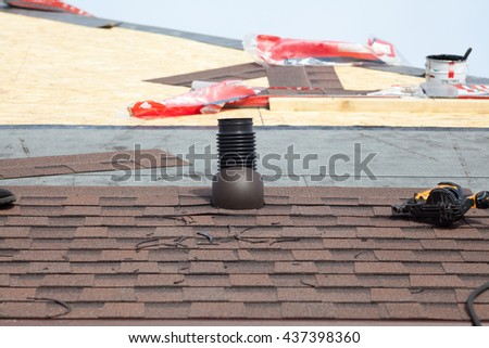 Shingles  roof ventilation for heat control with nailgun - stock photo