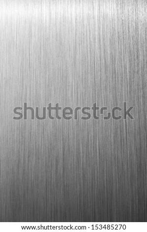 Shiny brushed metal background texture - stock photo