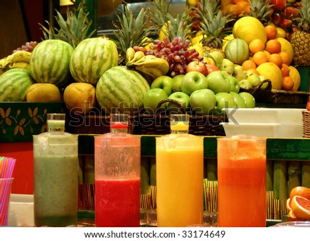 shop a bar on preparation and sale of natural fruit juices on eyes at the client. barcelona spain - stock photo