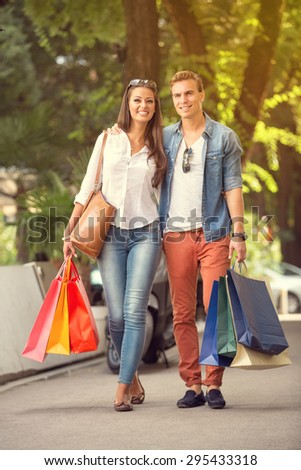 shopping couple with shopping bags walking  - stock photo