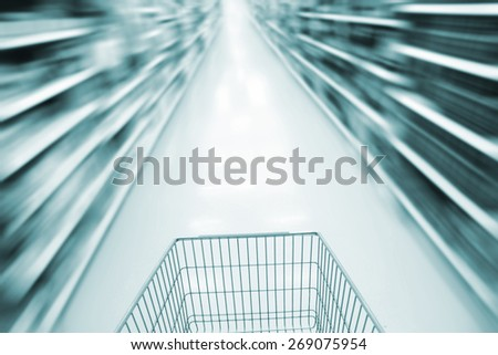 Shopping in supermarket. blurred shoping cart - stock photo