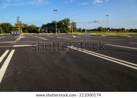 shopping trolleys on empty supermarket parking - stock photo