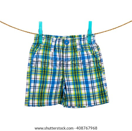 shorts hanging on the clothesline on white background