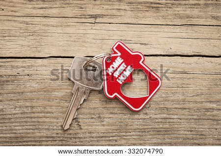 sign home sweet home on rustic wood - stock photo