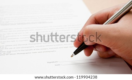 Signing the contract. - stock photo