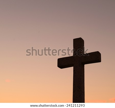 silhouette cross at sunset