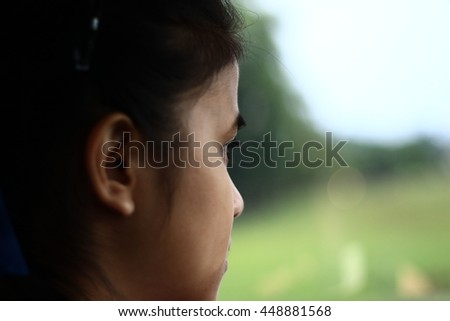Silhouette edge A child's eyes Asian love. Portrait of a cute Asian child girl and looking aside in-Thailand. - stock photo