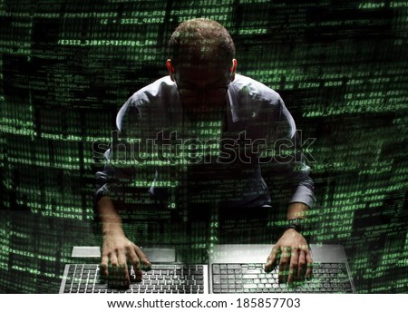 Silhouette hacker in futuristic environment hacking information on tech background with binary codes and words