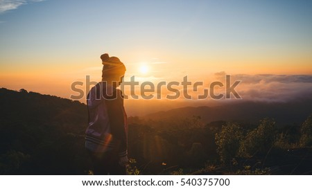 Silhouette loneliness and Fear woman in sunset
