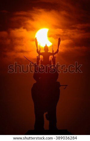 Silhouette Monument of King Naresuan . Sky Solar Eclipse
