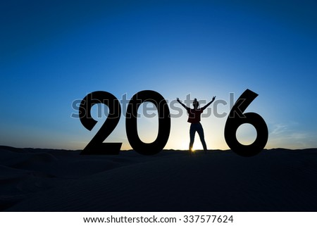 2016, silhouette of a woman standing in the sun, blue sky - stock photo