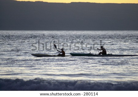 """Silhouette of two people kayaking in the sea, Maui, Hawaii, (Keith Levit)"""