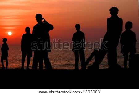Silhouettes on the beach (Goa, India). - stock photo