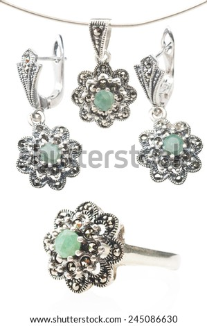 Silver collection of ring, earrings and pendent with emerald gemstone isolated on white background - stock photo