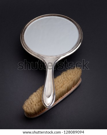 silver mirror and comb - stock photo
