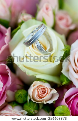 silver Wedding rings on the bouquet - stock photo
