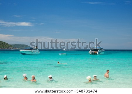 SIMILAN ISLAND THAILAND-APRIL 6 2014:Tourists swimming in the blue sea at similan island.