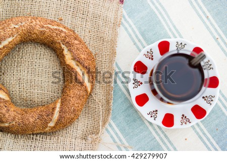 simit and tea on a blue plaid tabecloth in the  balcony at home top view