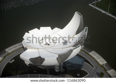 SINGAPORE - AUGUST 11: Flying saucer-shape Museum of Fine Arts on August 11, 2012 in Singapore. Singapore is not all about business, but the cultural center of South-East Asia as well. - stock photo