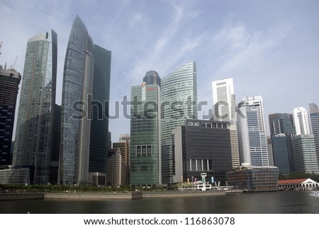 SINGAPORE - AUGUST 11: Padang District skyscrapers on August 11, 2012 in Singapore. The city state is one of the most dynamically developing countries in the world. It is the Asian financial center. - stock photo