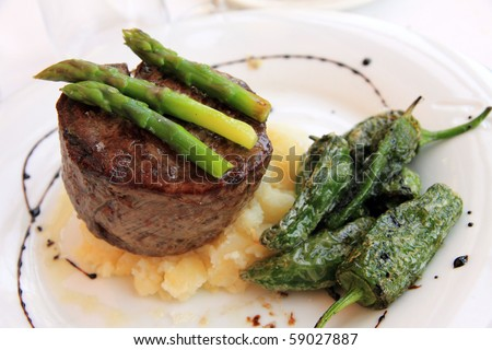 Sirloin steak with asparragus and green peppers Resort hotel Buenavista restaurant Denia Alicante Costa Blanca Spain - stock photo