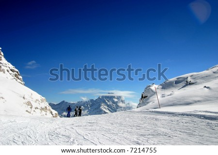 ski slope covered mountain side
