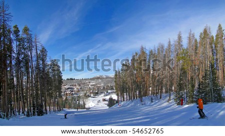 Skiers slide down to the resort base area in Steamboat Springs, Colorado