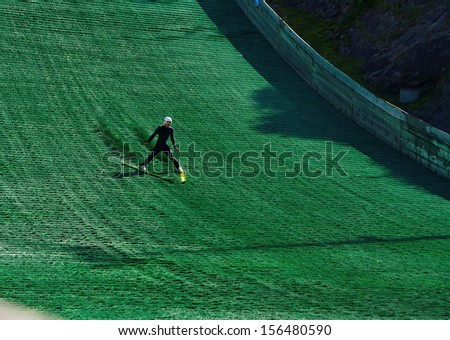 skiing downhill on artificial slope - stock photo