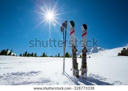 Skiing, winter season , mountains and ski equipment on ski run - stock photo