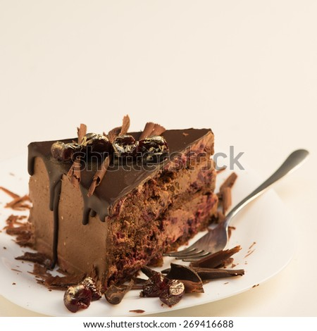 Slice of chocolate cake on white, selective focus - stock photo