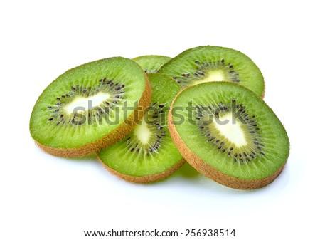 slices of a kiwi on a white background - stock photo