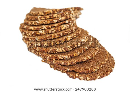 Slices of wholewheat bread isolated on white background - stock photo