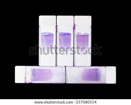 Slide blood smear on black background. - stock photo