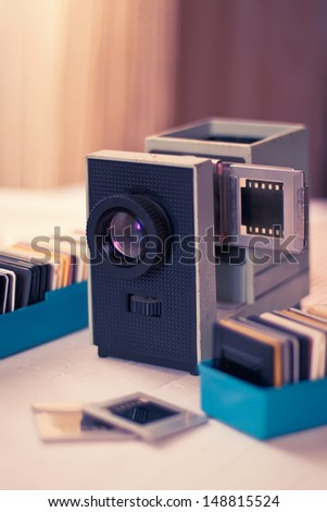 Slide projector and slides in a box