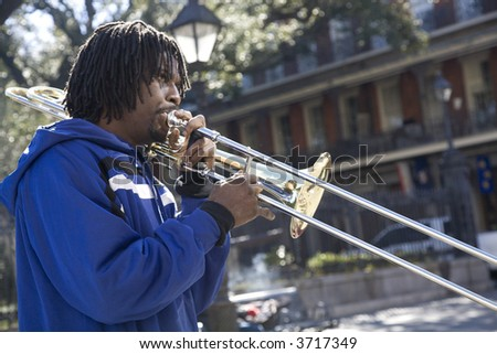 12-27-06 Slide Trombone player in Jackson Square in New Orleans - stock photo