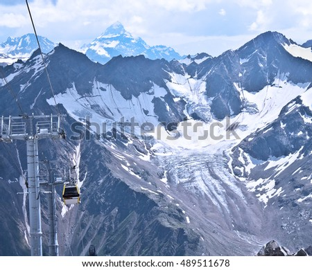 Slope on the skiing resort Elbrus. Caucasus, Russian Federation. Cable car on the ski resort.
